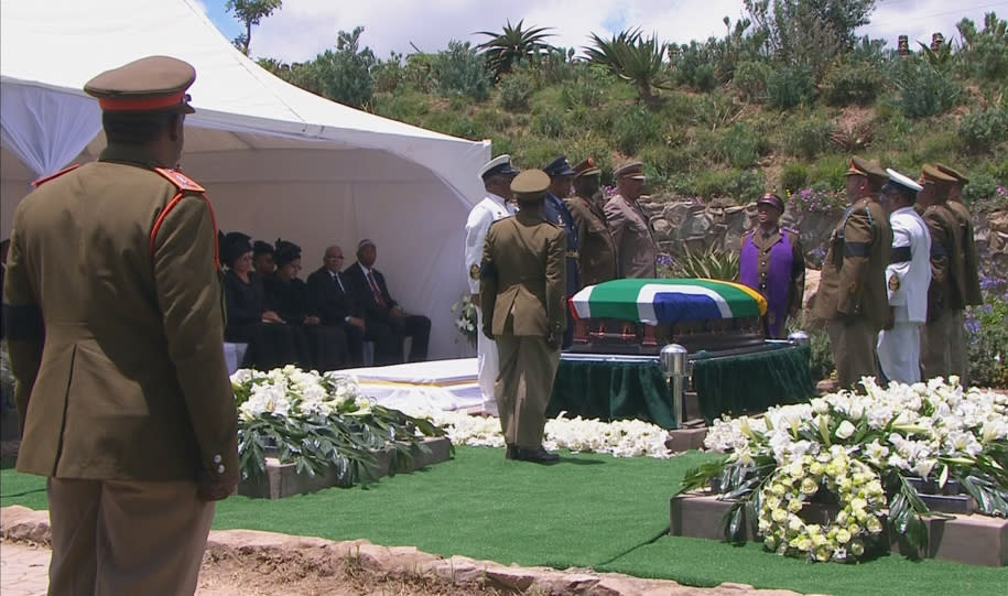 Military personnel stand beside coffin of former South African President Mandela at burial site in his ancestral village of Qunu