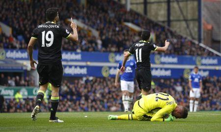 Britain Football Soccer - Everton v Chelsea - Premier League - Goodison Park - 30/4/17 Chelsea's Diego Costa is booked for a challenge on Everton's Maarten Stekelenburg Reuters / Phil Noble Livepic