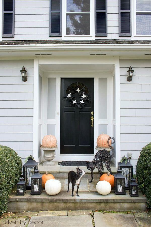 """<p>Keep your outdoor decor simple with pumpkins, lanterns, and a sassy black cat.</p><p><strong>Get the tutorial at <a href=""""https://www.drivenbydecor.com/halloween-decorating-ikea-sallskap/"""" rel=""""nofollow noopener"""" target=""""_blank"""" data-ylk=""""slk:Driven by Decor"""" class=""""link rapid-noclick-resp"""">Driven by Decor</a>.</strong> </p>"""