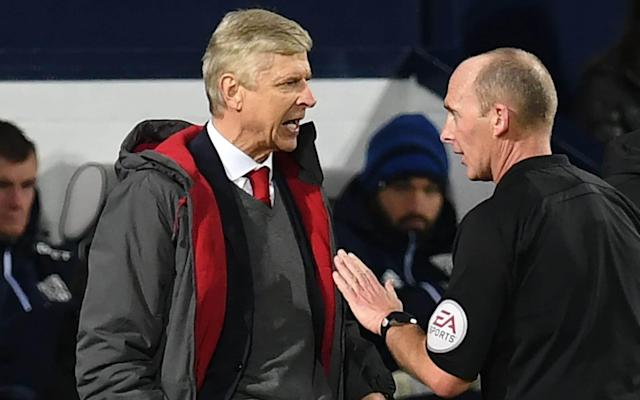 Arsene Wenger could face stadium ban after being accused of questioning Mike Dean's integrity