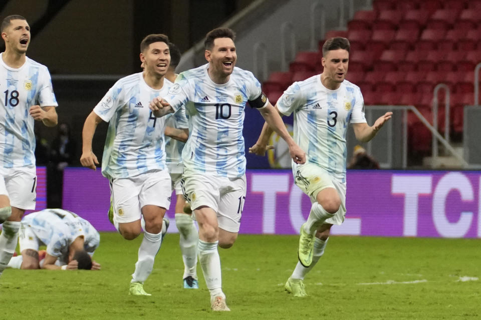 Argentina's Lionel Messi (10) and teammates celebrate defeating Colombia in a penalty shootout during a Copa America semifinal soccer match at the National stadium in Brasilia, Brazil, Wednesday, July 7, 2021. (AP Photo/Andre Penner)