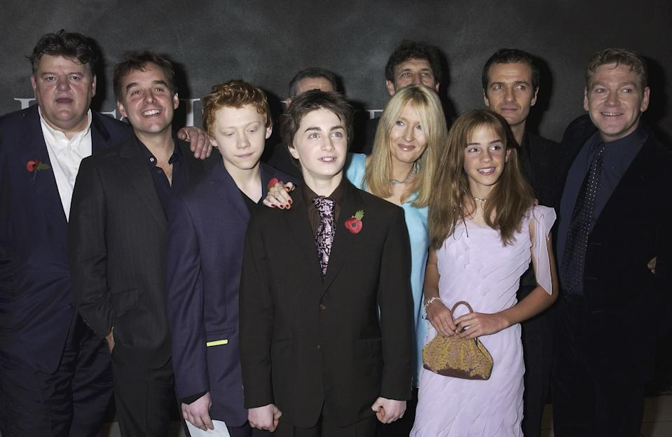 """LONDON - NOVEMBER 3: Robbie Coltrane, Rupert Grint, Daniel Radcliffe, J K Rowling, Emma Watson and Kenneth Branagh attend the UK Premiere of """"Harry Potter and the Chamber of Secrets"""" at The Odeon Cinema, Leicester Square on November 3, 2002 in London. (Photo by Dave Benett/Getty Images)"""