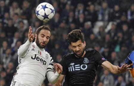 Soccer Football - Juventus v FC Porto - UEFA Champions League Round of 16 Second Leg - Juventus Stadium, Turin, Italy - 14/3/17 FC Porto's Miguel Layun in action with Juventus' Gonzalo Higuain Reuters / Giorgio Perottino Livepic