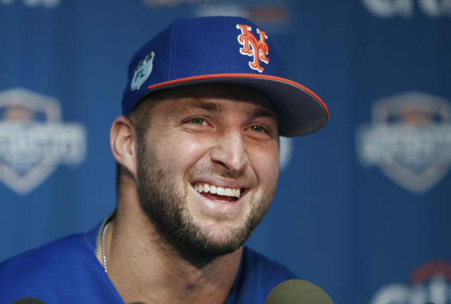 Tim Tebow is still playing baseball, and he'll be spending a little time in the Mets' major league spring training camp. (AP Photo)