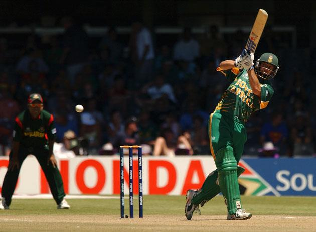 BLOEMFONTEIN - FEBRUARY 22:  Gary Kirsten of South Africa hits four runs during the ICC Cricket World Cup Pool B match played between Bangladesh and South Africa held on February 22, 2003 at Goodyear Park in Bloemfontein, South Africa.  South Africa won by 10 wickets.  (Photo by Stu Forster/Getty Images)