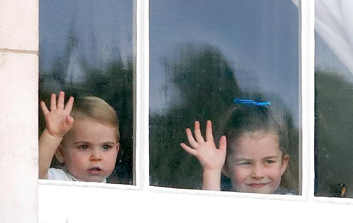 LONDON, UNITED KINGDOM - JUNE 08: (EMBARGOED FOR PUBLICATION IN UK NEWSPAPERS UNTIL 24 HOURS AFTER CREATE DATE AND TIME) Prince Louis of Cambridge and Princess Charlotte of Cambridge wave from a window of Buckingham Palace as they attend Trooping The Colour, the Queen's annual birthday parade, on June 8, 2019 in London, England. The annual ceremony involving over 1400 guardsmen and cavalry, is believed to have first been performed during the reign of King Charles II. The parade marks the official birthday of the Sovereign, although the Queen's actual birthday is on April 21st. (Photo by Max Mumby/Indigo/Getty Images)