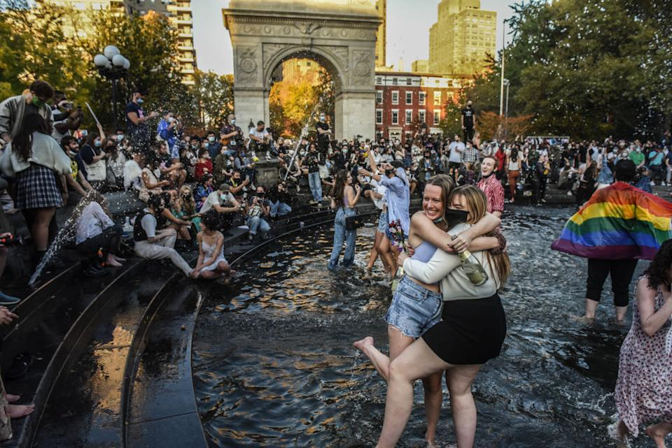 People stand in the fountain as they celebrate in Washington Square Park in New York City after it was announced that Democratic nominee Joe Biden would be the next U.S. president. (Photo by Stephanie Keith/Getty Images)