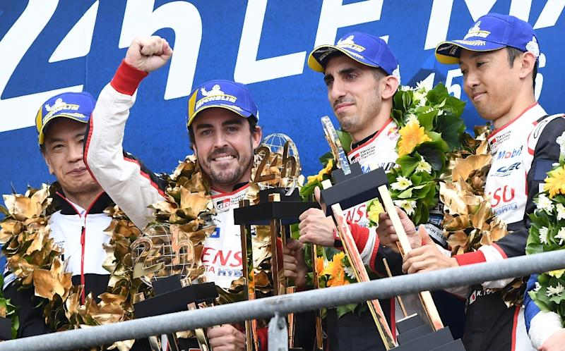 Fernando Alonso on the podium after back-to-back wins in the Le Mans 24 hour race (AFP Photo/Fred TANNEAU)