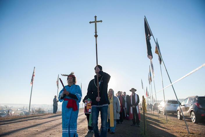 <p>Members of the clergy from across the United States participate in a march during a protest of the Dakota Access pipeline on the Standing Rock Indian Reservation near Cannonball, N.D., on Nov. 3, 2016. (Photo: Stephanie Keith/Reuters) </p>