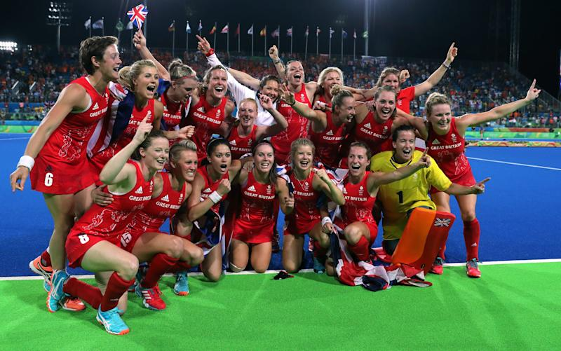 Team GB celebrate their gold medal win in the women's hockey - Women's sport is on the march – and cricket is the next frontier - Credit: PA
