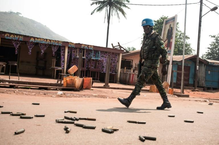 A UN peacekeeper patrols an area known as PK12 outside the Central African Republic's capital Bangui after a rebel attack