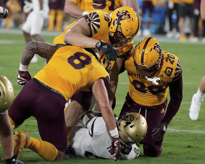 Arizona State defensive players Merlin Robertson (8) D.J Davidson (98) and Darien Butler (20) smother Colorado State tailback Alex Fontenot (8) during the first half of an NCAA college football game Saturday, Sept 25, 2021, in Tempe, Ariz. (AP Photo/Darryl Webb)