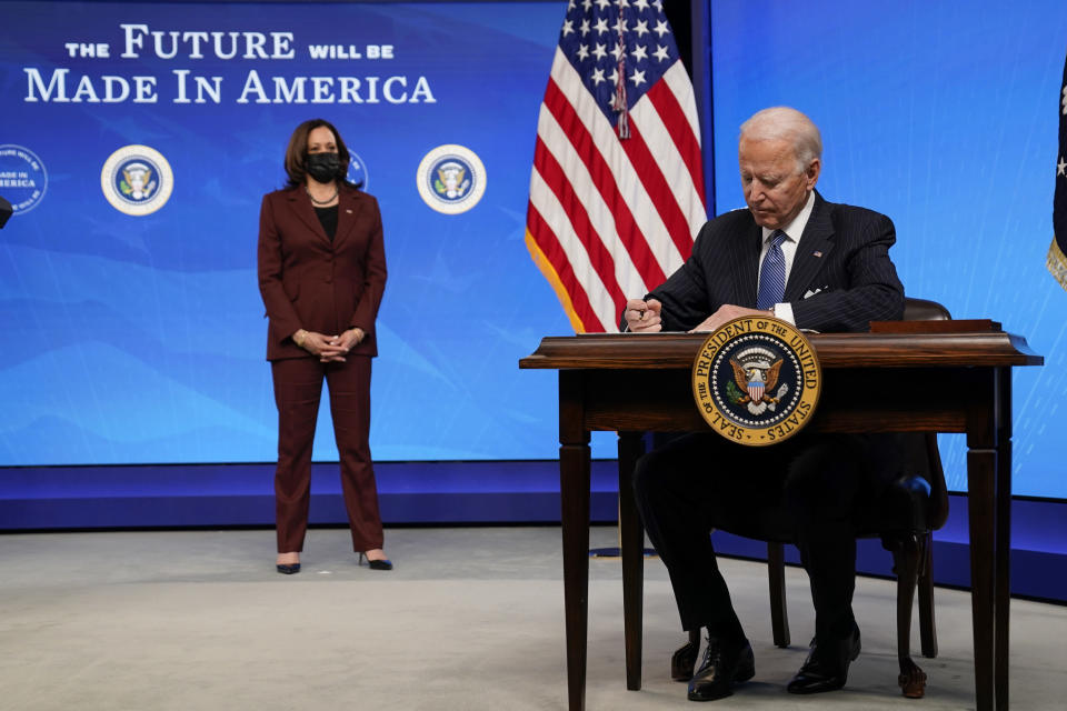 President Joe Biden signs an executive order on American manufacturing, in the South Court Auditorium on the White House complex, Monday, Jan. 25, 2021, in Washington. (AP Photo/Evan Vucci)
