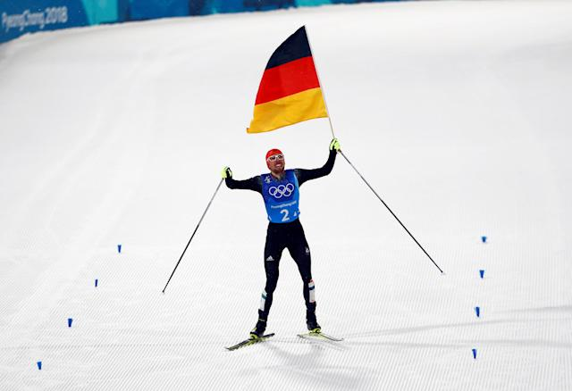 Nordic Combined Events - Pyeongchang 2018 Winter Olympics - Men's Team 4 x 5 km Final - Alpensia Cross-Country Skiing Centre - Pyeongchang, South Korea - February 22, 2018 - Johannes Rydzek of Germany waves the German flag as he approaches the finish line. REUTERS/Dominic Ebenbichler TPX IMAGES OF THE DAY