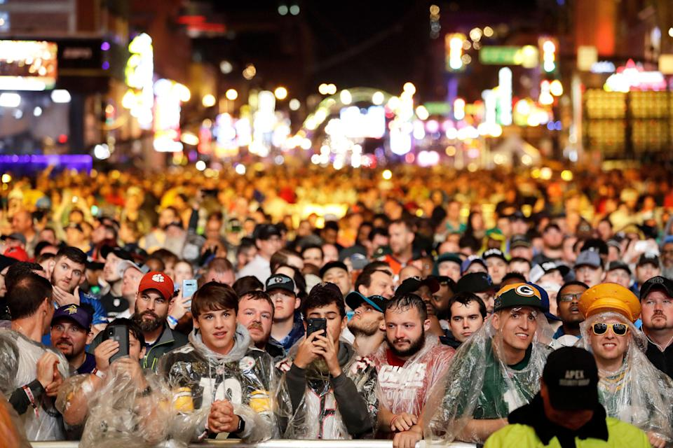 Spectators watch gthe main stage during the first round at the NFL football draft, Thursday, April 25, 2019, in Nashville, Tenn. (AP Photo/Steve Helber)