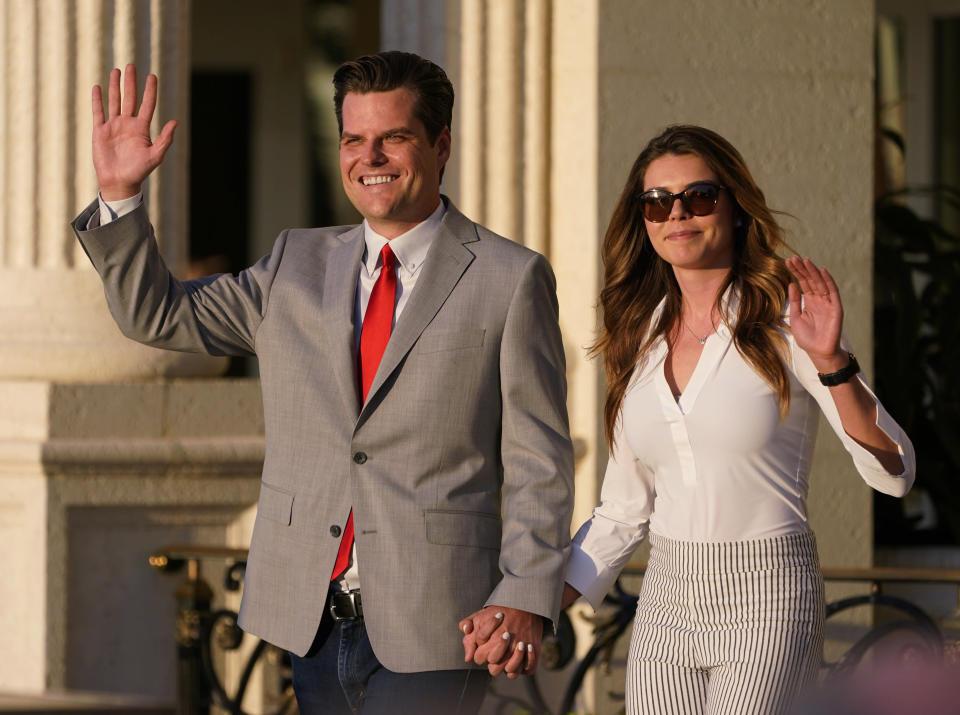 """Congressman Matt Gaetz, R-Fla., and his girlfriend Ginger Luckey enter """"Women for American First"""" event, Friday, April 9, 2021, in Doral, Fla. The House Ethics Committee has opened an investigation of Florida congressman Matt Gaetz, citing reports of sexual and other misconduct by the Florida Republican. (AP Photo/Marta Lavandier)"""