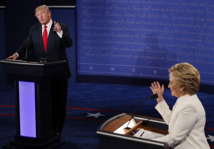 Donald Trump speaks as Hillary Clinton listens during their third and final 2016 presidential campaign debate. (Photo: Mark Ralston/Pool/Reuters)