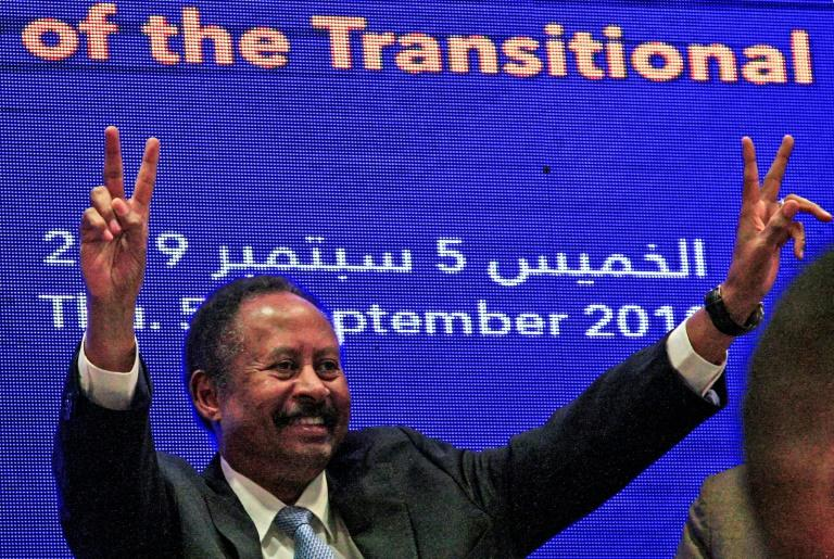 Sudan's new Prime Minister Abdalla Hamdok has formed a government comprising 18 ministers including the country's first ever female foreign affairs minister (AFP Photo/Ebrahim HAMID)
