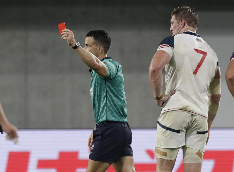 Referee Nick Berry shows a red card to United States' John Quill, right, during the Rugby World Cup Pool C game at Kobe Misaki Stadium, between England and the United States in Kobe, Japan, Thursday, Sept. 26, 2019. (AP Photo/Aaron Favila)