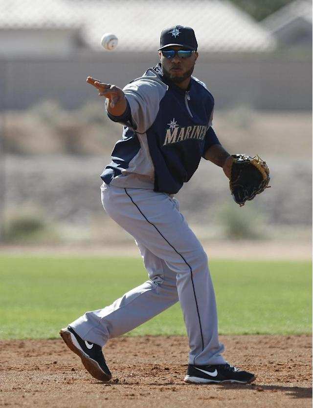 Seattle Mariners second baseman Robinson Cano (22) flips the ball to second 2wbbbase during spring training baseball practice, Tuesday, Feb. 18, 2014, in Peoria, Ariz. (AP Photo/Rick Scuteri)