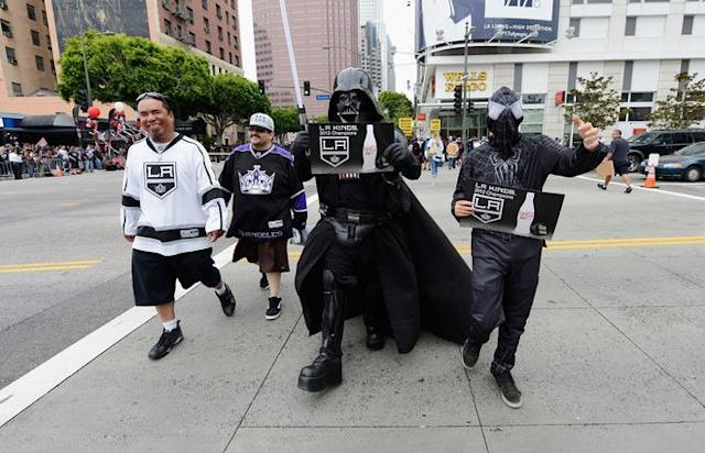 LOS ANGELES, CA - JUNE 14: People dressed as Darth Vader and Spiderman arrive for the Stanley Cup victory parade on June 14, 2012 in Los Angeles, California. The Kings are celebrating their first NHL Championship in the team's 45-year-old franchise history. (Photo by Kevork Djansezian/Getty Images)
