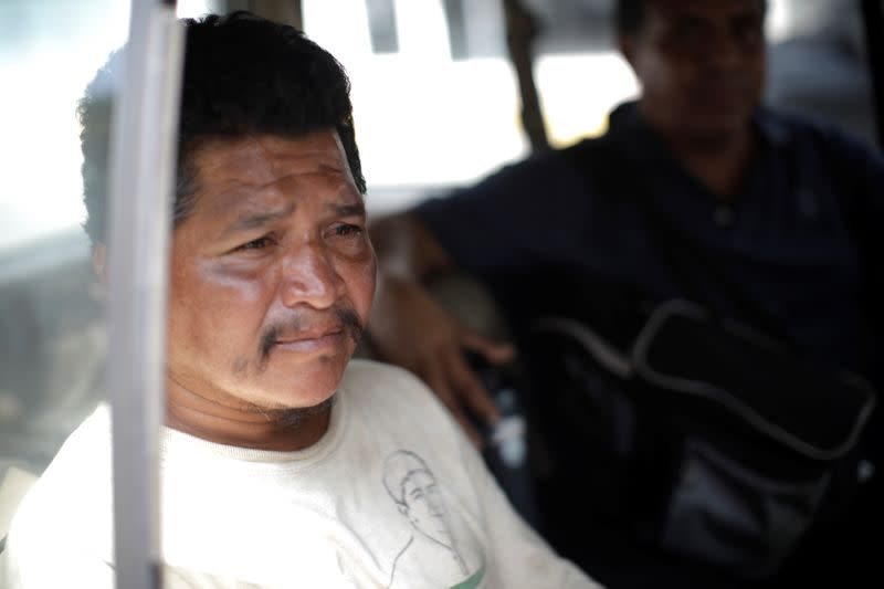 Guatemalan migrant Wilfredo Gomez sits in a car as he goes to a shelter in Tapachula