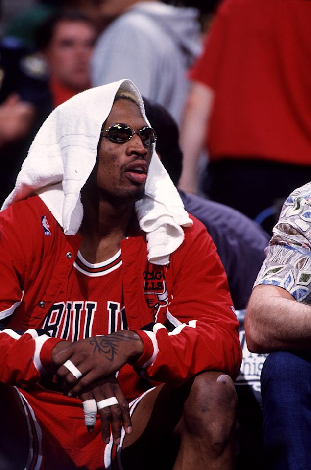1997:  Dennis Rodman of the Chicago Bulls on the bench during the a Bulls playoff game versus the Atlanta Hawks at the Omni Center in Atlanta, GA.  (Photo by John Biever/Icon Sportswire via Getty Images)