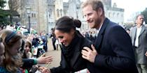 <p>At the Cardiff Castle in Wales, the couple greeted young fans, signing autographs outside the gates. While the school-age admirers shared a special up-close interaction with the royal-to-be, Harry stood beside his fiancé, offering a supportive hand on her shoulder.</p>