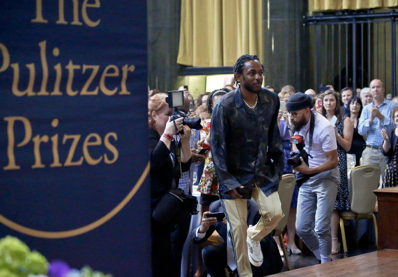 "FILE - In this May 30, 2018 file photo, Kendrick Lamar walks onto the stage to accept the Pulitzer Prize for music for his album ""DAMN,"" during the 2018 Pulitzer Prize awards luncheon at Columbia University in New York. (AP Photo/Bebeto Matthews, File)"