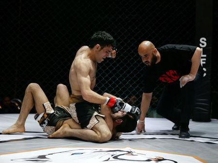Afghan competitors fight during a mixed martial arts (MMA) match in Kabul, Afghanistan