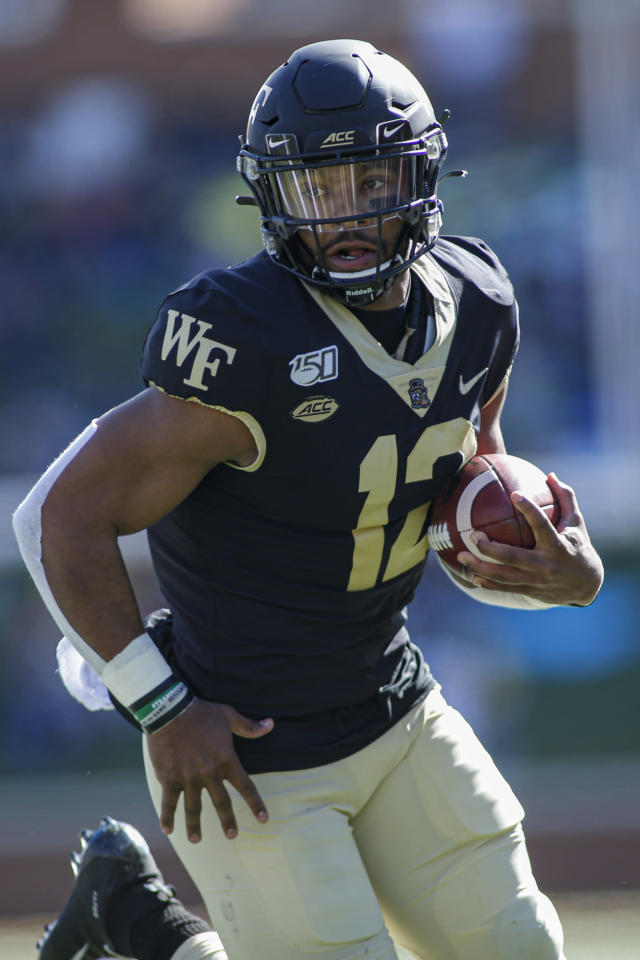 Wake Forest quarterback Jamie Newman runs for a touchdown against North Carolina State in the first half an NCAA college football game in Winston-Salem, N.C., Saturday, Nov. 2, 2019. (AP Photo/Nell Redmond)