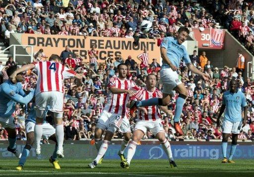 Manchester City's Javi Garcia (2nd R) heads the ball to score against Stoke City during their Premiership football match at The Brittania Stadium in Stoke. Garcia rescued the Premier League champions as his debut goal earned a 1-1 draw at Stoke