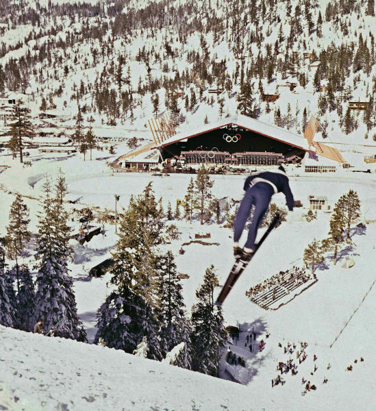 FILE - This Feb. 1, 1960, file photo shows a ski jumper during the 1960 Winter Olympics at the Squaw Valley ski resort in California. California and Nevada officials announced Thursday, April 5, 2012, that they are joining forces in their effort to lure the Winter Games back to the Lake Tahoe area in 2022, forming an exploratory committee to start the process. (AP Photo/File)