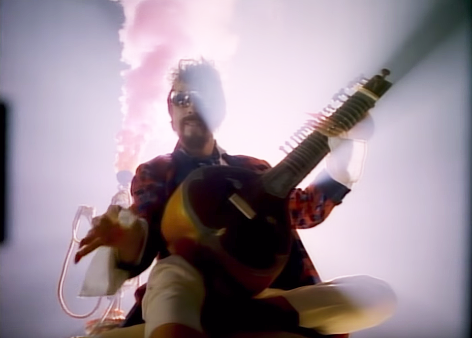 Dave Stewart in Tom Petty's 'Don't Come Around Here No More' video. (Photo: MCA Records)