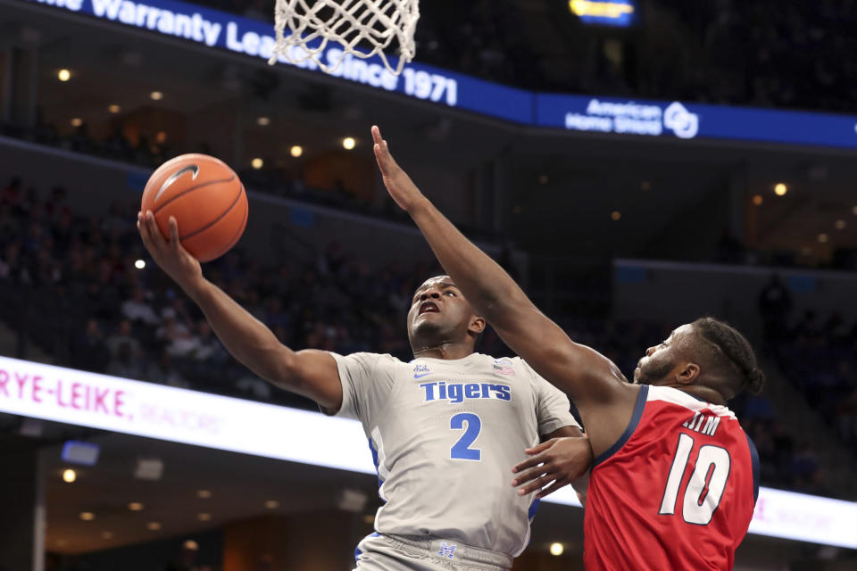 Memphis' Alex Lomax (2) goes up for a shot as Illinois-Chicago's Deon Ejim (10) defends during the second half of an NCAA college basketball game, Friday, Nov. 8, 2019, in Memphis, Tenn. (AP Photo/Karen Pulfer Focht)