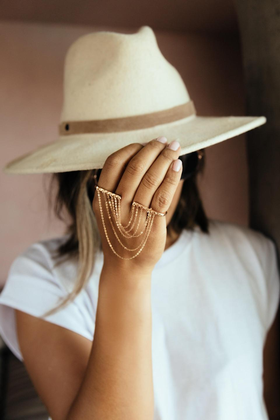 """<p>Klarissa Mae is a Filipina American based in Los Angeles. A positive psychotherapist by training, she has always been passionate about helping women discover their true potential, feel empowered and believe they belong. Each ethically-sourced gold jewellery inspires women to be true to themselves. <a href=""""https://kmaejewelry.com/collections/hand-jewelry/products/sashet?variant=33136666345612"""" rel=""""nofollow noopener"""" target=""""_blank"""" data-ylk=""""slk:kmaejewelry.com"""" class=""""link rapid-noclick-resp"""">kmaejewelry.com</a></p> <p><em>Follow them on Instagram</em> <a href=""""https://www.instagram.com/kmaejewelry/?hl=en"""" rel=""""nofollow noopener"""" target=""""_blank"""" data-ylk=""""slk:@kmaejewelry"""" class=""""link rapid-noclick-resp""""><em>@kmaejewelry</em></a></p>"""