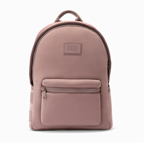 """<h2>Dagne Dover Dakota Backpack</h2> <br>Every mom needs <a href=""""https://www.refinery29.com/en-us/best-gym-bags-for-women"""" rel=""""nofollow noopener"""" target=""""_blank"""" data-ylk=""""slk:a classy neoprene bag"""" class=""""link rapid-noclick-resp"""">a classy neoprene bag</a> to take to the gym, the yoga studio, and everywhere else.<br><br><strong>Dagne Dover</strong> Dakota Backpack, $, available at <a href=""""https://go.skimresources.com/?id=30283X879131&url=https%3A%2F%2Fwww.dagnedover.com%2Fcollections%2Fthe-dakota-backpack%23Dune-Large"""" rel=""""nofollow noopener"""" target=""""_blank"""" data-ylk=""""slk:Dagne Dover"""" class=""""link rapid-noclick-resp"""">Dagne Dover</a><br>"""