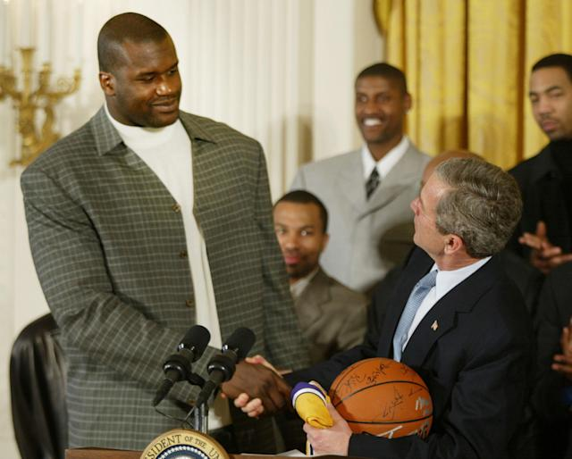 "President George W. Bush (right) welcomes Shaquille O'Neal and the <a class=""link rapid-noclick-resp"" href=""/nba/teams/la-lakers/"" data-ylk=""slk:Los Angeles Lakers"">Los Angeles Lakers</a> to the White House. (Getty)"