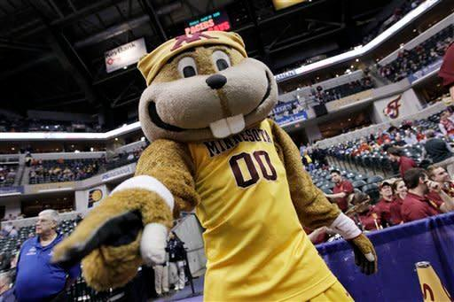 The Minnesota mascot performs in the first half of an NCAA college basketball game against Northwestern at the first round of the Big Ten Conference tournament in Indianapolis, Thursday, March 8, 2012. (AP Photo/Michael Conroy)