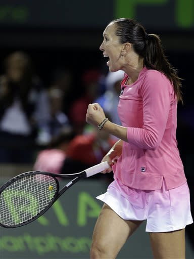 Jelena Jankovic of Serbia, celebrates after defeating Roberta Vinci of Italy, 6-4, 6-7(6) 6-3 during the Sony Open tennis tournament, Wednesday, March 27, 2013 in Key Biscayne, Fla. (AP Photo/Wilfredo Lee)
