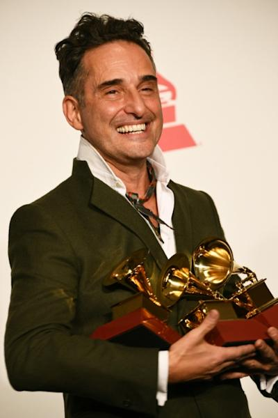 Uruguayan musician Jorge Drexler poses with his awards at the Latin Grammys in Las Vegas
