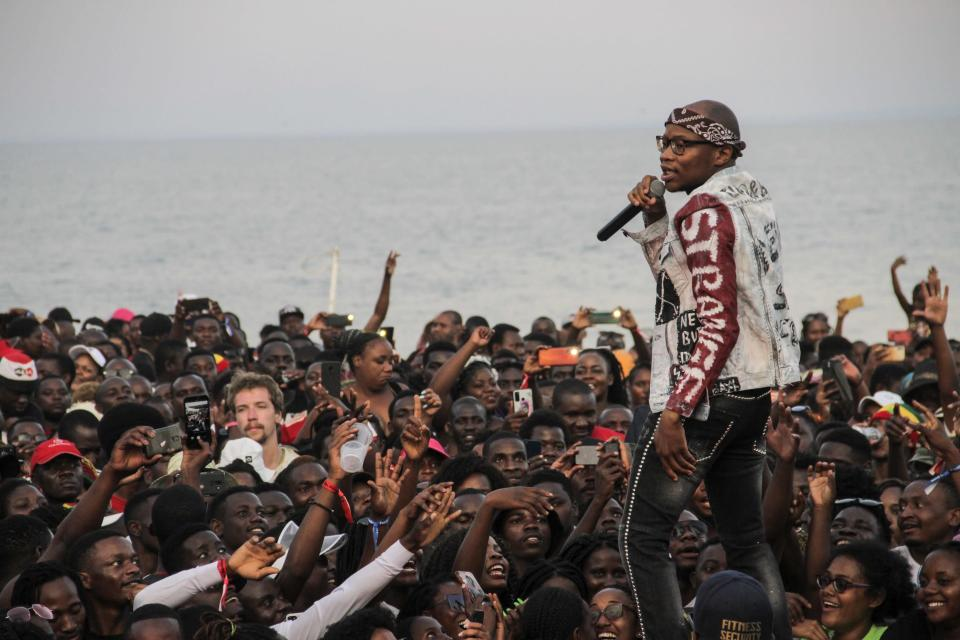 """Master KG (R), The South African DJ behind the global pop hit """"Jerusalema"""", performs at the Sand Festival held on the beaches of Lake Malawi, in Salima on November 1, 2020."""