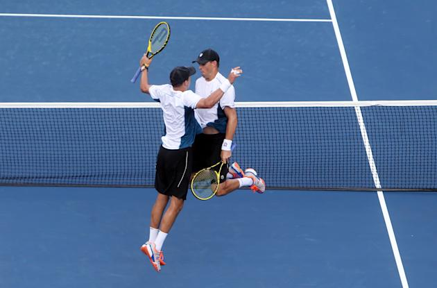 Sep 1, 2014; New York, NY, USA; Mike Bryan (USA), left, and Bob Bryan (USA), right, celebrate after recording match point against Bradley Klahn (USA) and Tim Smyczek (USA) on day eight of the 2014 U.S. Open tennis tournament at USTA Billie Jean King National Tennis Center. (Jerry Lai-USA TODAY Sports)