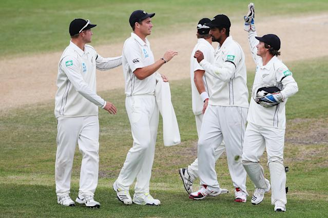 DUNEDIN, NEW ZEALAND - DECEMBER 07: New Zealand celebrate bowling the West Indies out during day five of the first test match between New Zealand and the West Indies at University Oval on December 7, 2013 in Dunedin, New Zealand. (Photo by Hannah Johnston/Getty Images)