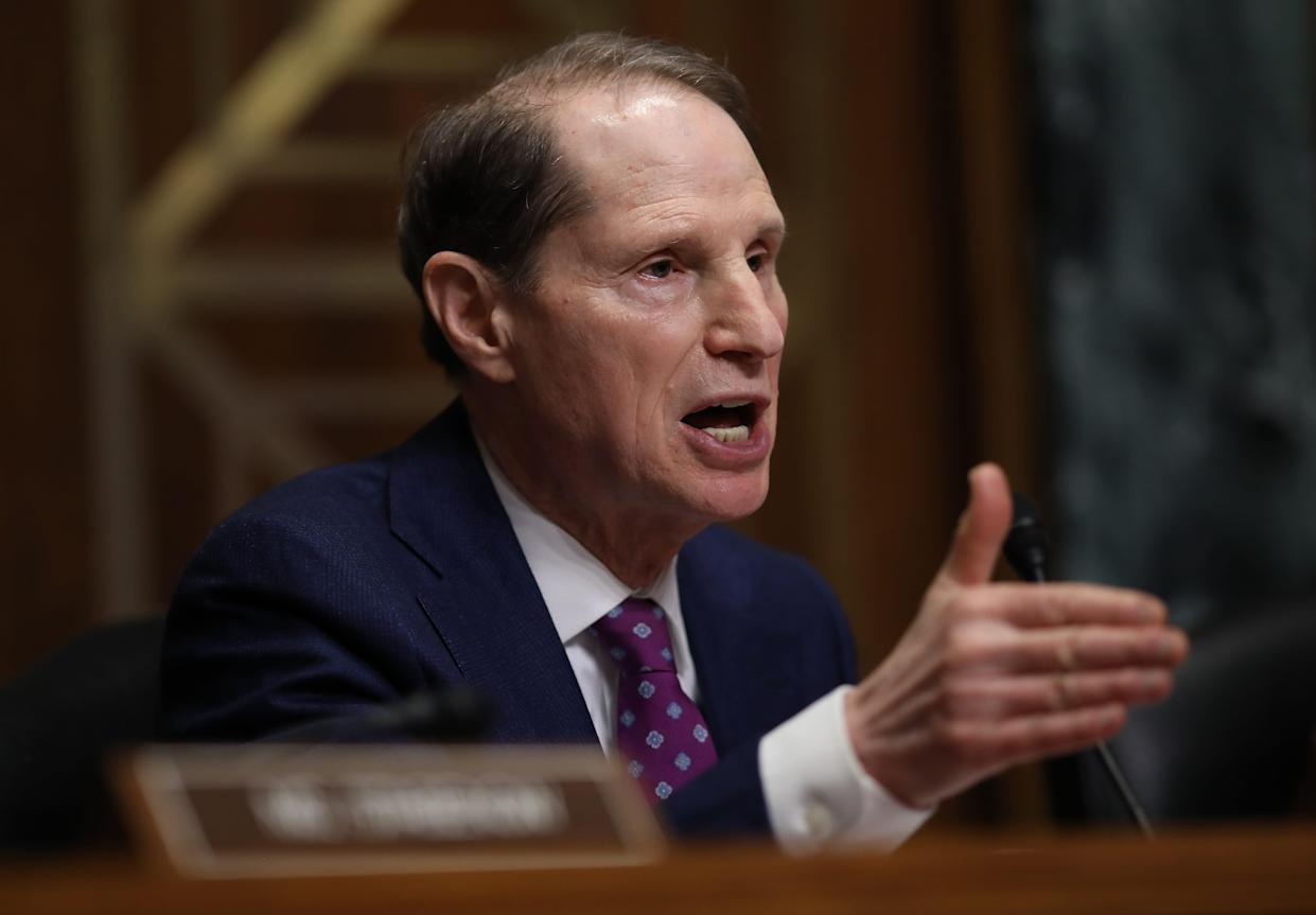 WASHINGTON, DC - FEBRUARY 26: Sen. Ron Wyden (D-OR) asks questions to a panel of pharmaceutical company CEOs during a hearing held by the Senate Finance Committee on
