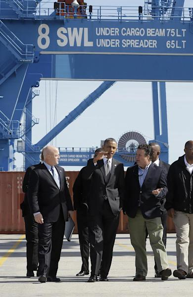President Barack Obama talks with Ports American General Manager Keith Palmisano, right, as he tours the Port of New Orleans, Friday, Nov. 8, 2013 in New Orleans. Obama traveled to the Gulf Coast region to make a case that more exports equal more jobs. After New Orleans he will go to Miami area for three Democratic fundraisers. At left is New Orleans Mayor Mitch Landrieu. (AP Photo/Pablo Martinez Monsivais)