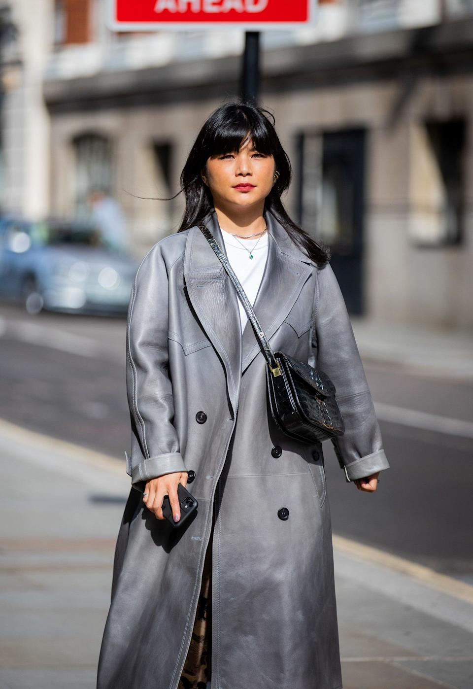"""This floor-length grey coat really makes a statement (and will have its wearer covered from now until winter).<span class=""""copyright"""">Photo Courtesy of Christian Vierig/Getty Images.</span>"""