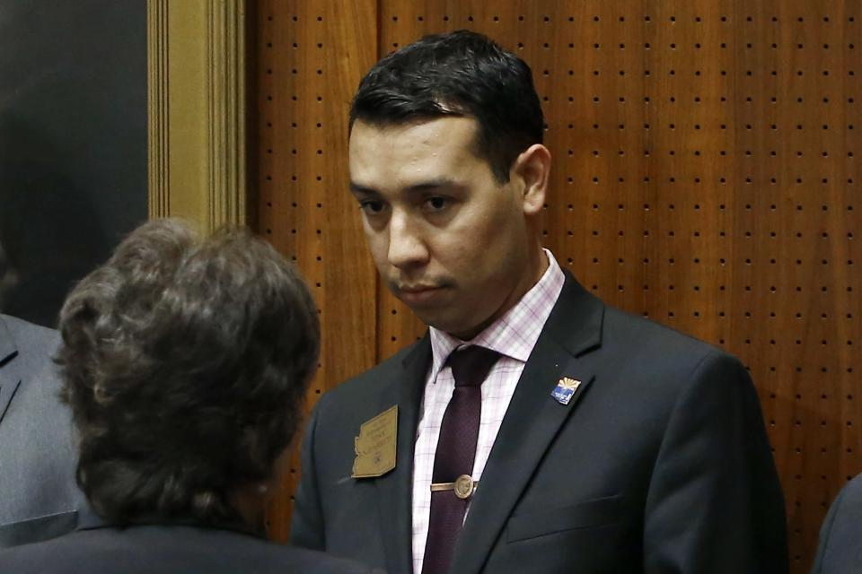 FILE - In this Wednesday, May 10, 2017 file photo, then-Arizona state Rep. Tony Navarrete, D-Phoenix, listens to a colleague on the floor of the at the Arizona Capitol Wednesday, May 10, 2017, in Phoenix. Currently, an Arizona State Senator, Navarrete has been arrested on suspicion of charges accusing him of sexual conduct with a minor, police said Friday, Aug. 6, 2021. (AP Photo/Ross D. Franklin, File)
