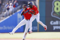 Cleveland Indians' Amed Rosario, right, celebrates with Franmil Reyes after hitting a game winning single off Chicago Cubs pitcher Keegan Thompson during the tenth inning of a baseball game, Wednesday, May 12, 2021, in Cleveland. The Indians defeated the Cubs 2-1. (AP Photo/Ron Schwane)