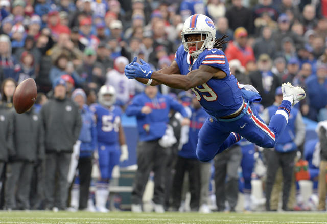 <p>Buffalo Bills running back Travaris Cadet (39) tries to make a catch on a pass from quarterback Joe Webb (14) during the first half of an NFL football game against the New England Patriots, Sunday, Dec. 3, 2017, in Orchard Park, N.Y. (AP Photo/Adrian Kraus) </p>